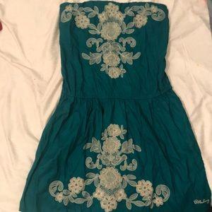 Teal-green strapless dress